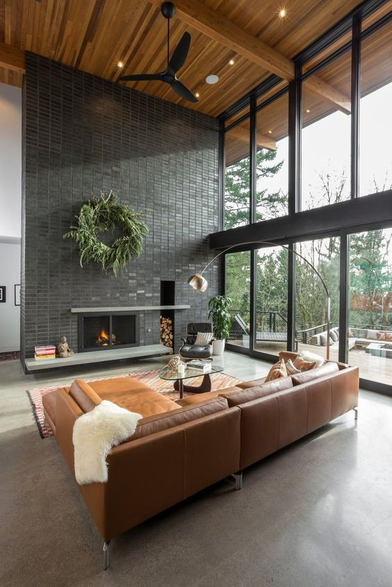 Living room Tagged: Living Room, Accent Lighting, Concrete Floor, Standard Layout Fireplace, Ceiling Lighting, Sectional, Chair, Floor Lighting, Recessed Lighting, Wood Burning Fireplace, and Coffee Tables. The Greenhills House by Craig Wollen